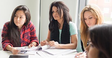 Image of 3 female students in a classroom