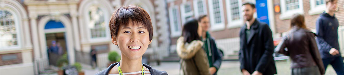 Smiling student - Choosing the right postgraduate course